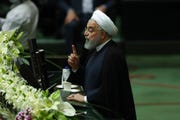 Iranian President Hassan Rouhani speaks during the inauguration of the new parliament in Tehran, Iran, Wednesday, May, 27, 2020.