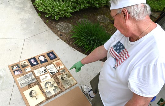 Richard Rasmussen of Midland tries to salvage family photographs damaged by flooding last week on Wednesday, May 27, 2020.