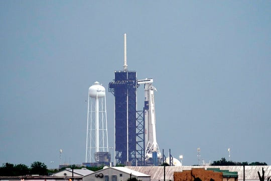 The SpaceX Falcon 9, with the Crew Dragon spacecraft on top of the rocket, sits on Launch Pad 39-A Wednesday, May 27, 2020, at Kennedy Space Center in Cape Canaveral, Fla. Two astronauts will fly on the SpaceX Demo-2 mission to the International Space Station scheduled for launch Wednesday afternoon.