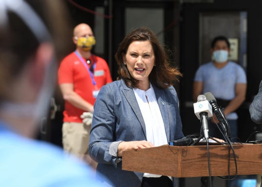 Gov. Gretchen Whitmer speaks during a news conference regarding the state's response to the emergency regarding dam conditions and flooding  in Midland and Sanford on Wednesday, May 27, 2020 at Meridian Elementary School in Sanford.