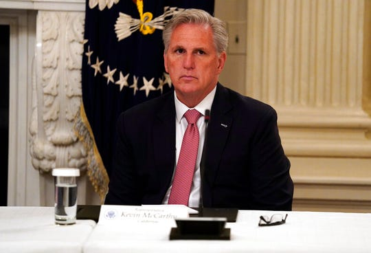 House Minority Leader Kevin McCarthy of Calif. listens during a meeting between President Donald Trump and Republican lawmakers in the State Dining Room of the White House, Friday, May 8, 2020, in Washington. McCarthy considers proxy voting by House members unconstitutional.