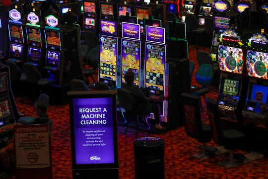 A woman gambles on Wednesday, May 27, 2020, at Oneida Casino in Ashwaubenon, Wisconsin. The Oneida Casino reopened on Tuesday. There are different policies and procedures put in place to keep gamblers safe. Temperatures are scanned once you enter the building, every other seat for most machines are blocked off for social distancing purposes and machines are cleaned frequently. Ebony Cox/USA TODAY NETWORK-Wisconsin
