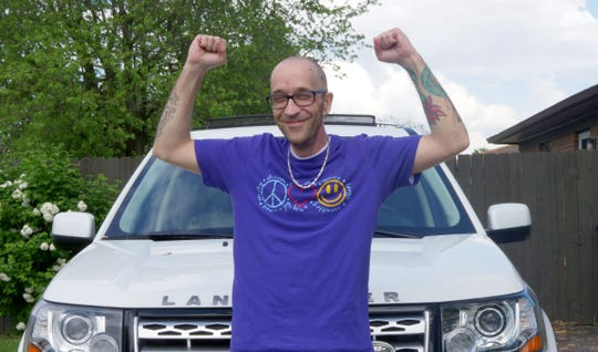 Tyson Timbs sits in his Land Rover. State authorities returned the vehicle to Timbs on May 26, more than six years after seizing it over drug offenses.