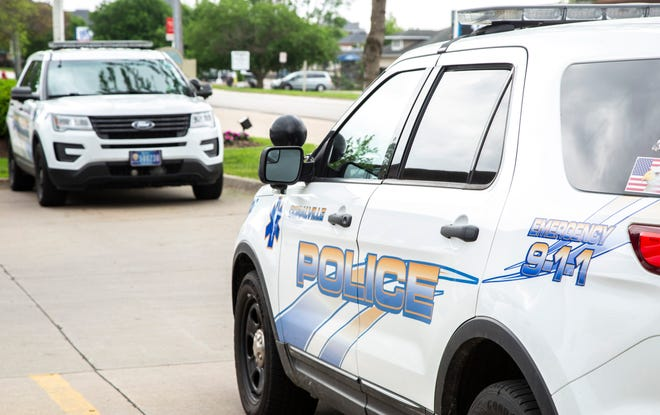 Coralville police cars are seen, Wednesday, May 27, 2020, outside City Hall in Coralville, Iowa.
