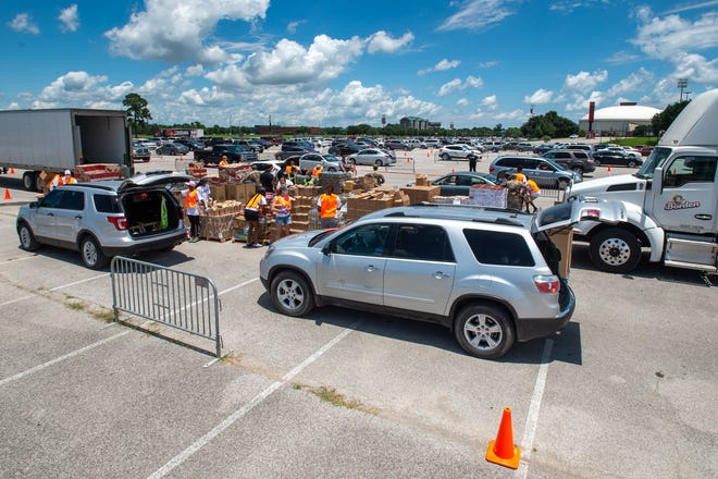 Volunteers from United Way of Acadiana, Second Harvest Food Bankandthe University of Louisiana at Lafayette distribute food supplies at acontact-free, drive-thru food distribution for anyone experiencing economic hardship.Wednesday, May 27, 2020.