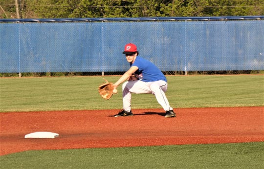 Lancaster Post 11's Gavin Rowland gets set to field a ground ball during Tuesday's practice at Beavers Field.