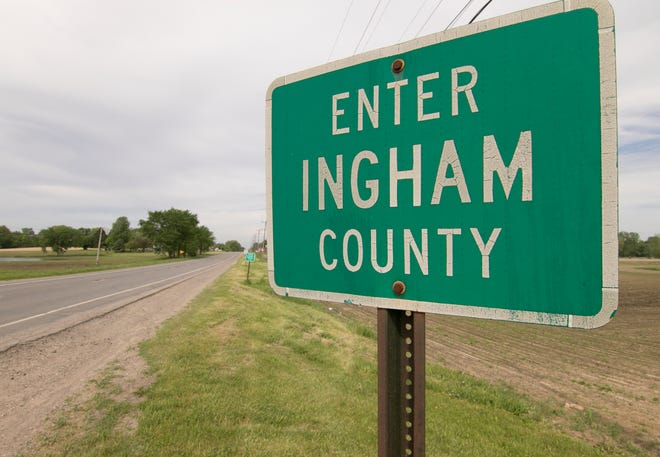 A sign indicating the Ingham County line from Livingston County on Grand River Avenue west of Wallace Road bordering Leroy and Handy Townships. Livingston County officials want the county group with Lansing area counties, rather than southeast Michigan counties, as Gov. Gretchen Whitmer loosens restrictions.