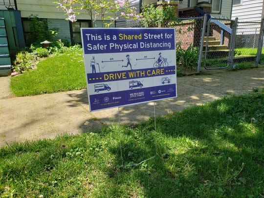 A sign along N. Fratney St. north of E. Meinecke Ave. reminds people to drive with care on May 27, 2020. The street is closed as part of Milwaukee Active Streets, a program launched by the city and county to create more space for walking and cycling during the coronavirus pandemic.