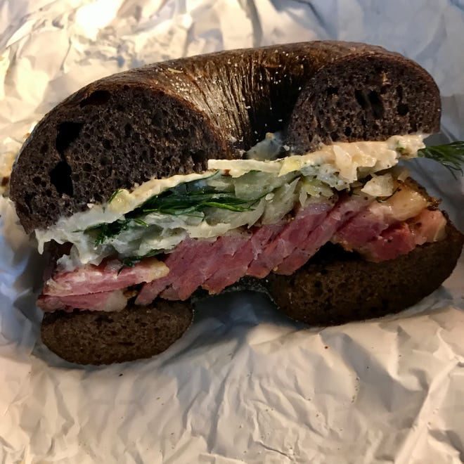 The smoked pastrami sandwich at Allie Boy's Bagelry & Luncheonette, 135 E. National Ave., is layered with horseradish sauerkraut and French onion schmear.