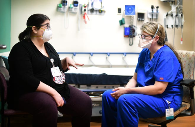 Social worker Angie Desjarlais talks with advanced practice nurse Sara Wawrzyniak at Children's Wisconsin. Both work in the emergency department and have been involved in planning a new mental health team.