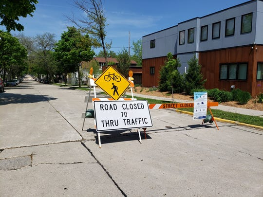 A barricade on N. Fratney Street at E. Meinecke Ave. indicates the street is closed to through traffic on May 27, 2020. The street is closed as part of Milwaukee Active Streets, a program launched by the city and county to create more space for walking and cycling during the coronavirus pandemic.