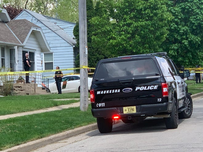 Waukesha police are stationed outside a home in the 900 block of Lawndale Avenue where two people died on Wednesday, May 27. Police are investigating it as a murder-suicide.