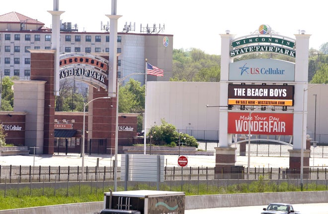 A sign along I-94 on Tuesday promotes the Beach Boys' appearance at the 2020 Wisconsin State Fair. Officials are considering canceling this year's fair because of the coronavirus.