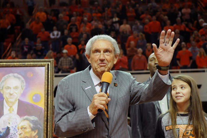 FILE - In this Monday, Feb. 3, 2014, file photo, Eddie Sutton, head coach at Oklahoma State between 1990-2006, is honored at halftime of the Oklahoma State basketball game against Iowa State in Stillwater, Okla. Sutton, the Hall of Fame basketball coach who led three teams to the Final Four and was the first coach to take four schools to the NCAA Tournament, died Saturday, May 23, 2020. He was 84. (AP Photo/Brody Schmidt, File)