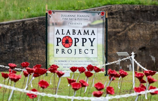 1,001 ceramic poppies are on display for Memorial Day week in downtown Prattville, Ala., on Wednesday May 27, 2020, as part of the Alabama Poppy Project. The flowers have ribbons attached that show veterans names who were killed in wars or are no longer with us.