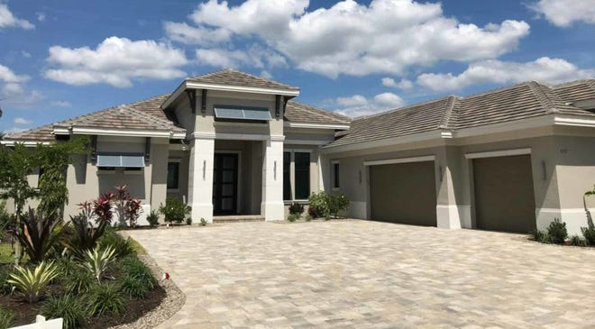 The Cambridge II, by Florida Lifestyle Homes, offers golf course and lake views.