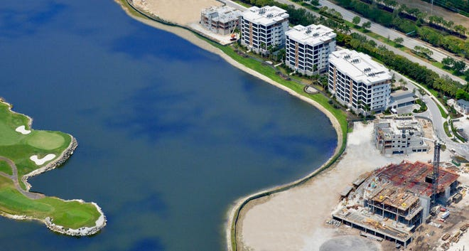 Aerial showing completed residences in Phase 1 as well as the future Clubhouse at Moorings Park Grande Lake (bottom right).