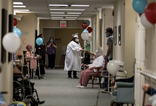 Nicole Price, a CTEC Clinical Care senior, has been employed at Chestnut House Assisted Living in Newark for 2 years.Nicole was at work the day she learned she wouldn't get a typical graduation. So the Chestnut house team came up with a surprise party and graduation for her. Residents gave Price flowers or balloons as she walked the halls for her graduation in cap and gown.