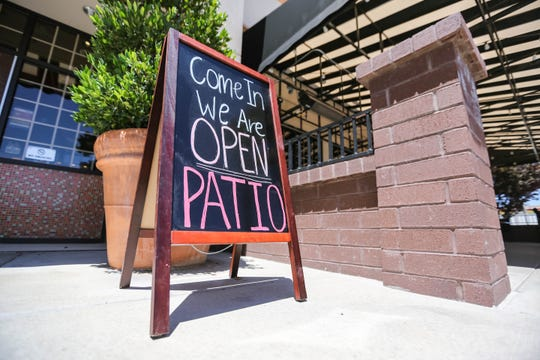 A sign that says the patio is open is displayed at the Corner Bakery Cafe on Lohman Avenue in Las Cruces on Wednesday, May 27, 2020. The restaurant later removed the sign, saying the patio would not open until June 1.