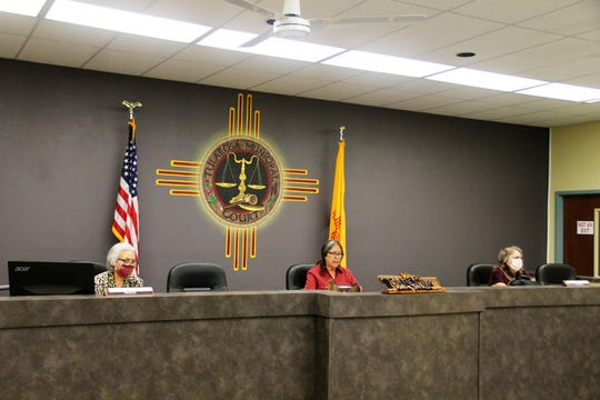 Tularosa Board of Trustees sitting in a socially distanced setting.  From left: Trustee Jeni Alexander, Tularosa Mayor Margaret Trujillo and Trustee Jamie Portillo.  Not pictured are Trustees Patrick Garcia and Robert Sainz who were seating at tables in front of the dais.