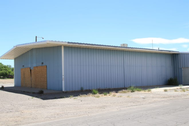 A vacant warehouse located at 109 E. Pinon St. in south Farmington sits empty on Wednesday, May 27, 2020.