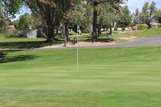 The 17th green at San Juan County Club sits quiet on Wednesday, May 27, 2020, in Farmington.
