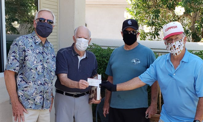 Sun City softball board members Rocky Thomas and Marc Klugman, along with softball president Greg Howser, present a check to Frank Riley, who helped organize the fundraiser