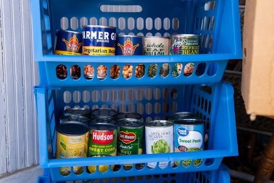 Shelves full of canned goods including beans, sweet peas and artichoke hearts can be seen at the Miller's Share Table on Tuesday, May 26, 2020.