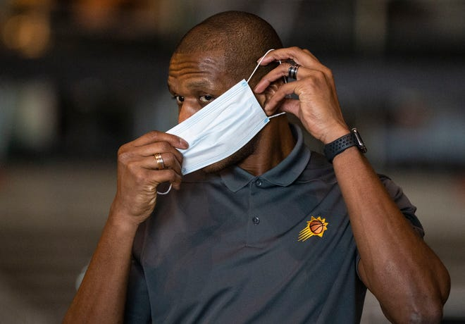 May 26, 2020; Phoenix, AZ, USA; Phoenix Suns General Manager James Jones puts on his mask during a tour of the renovations at Talking Stick Resort Arena in Phoenix.