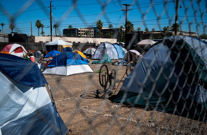 One of the socially distanced parking lots designated for people experiencing homelessness to camp is seen outside the Human Services Campus in Phoenix on May 27, 2020.
