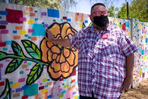 Phoenix Elementary School District teacher Chico Robinson stands for a portrait on May 27, 2020, at his home in Phoenix.