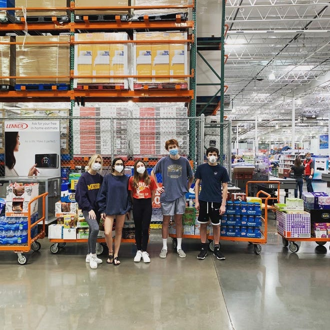 From left to right: Caroline Purtill,  Alex Goldstein, Sierra Goldstein  Ben Richardson snd Max Goldstein in front of one of their supply hauls.