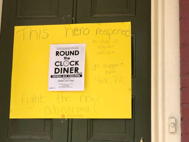 A sign on the door of a home in Lititz, Lancaster County, urging passersby to support Round the Clock Diner in York County.