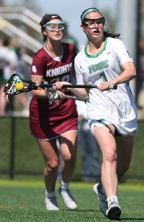 York College women's lacrosse player Regan Cook, right, has accumulated a number of honors during her career with the Spartans.