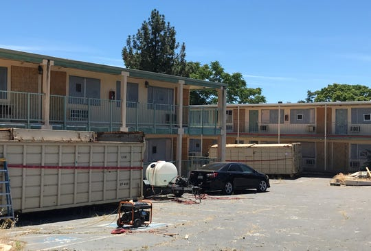 On Wednesday, May 27, 2020, two large trash containers sat in the parking lot of the former Redding Inn.