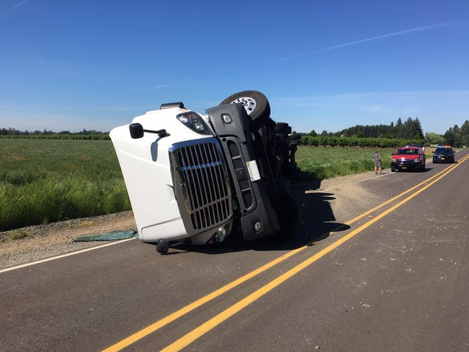 An overturned truck blocks Sunnyview Road NE east of Salem on Wednesday, May 27, 2020.