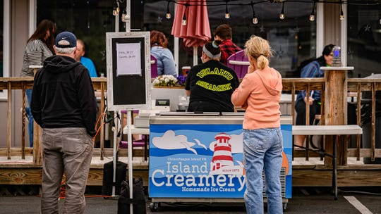 Pre-packaged pints and quarts of ice cream were available at a separate stand outside The Island Creamery in Chincoteague on Monday, May 25, 2020, for Memorial Day.