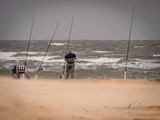A hopeful fisherman has his lines cast on Chincoteague on Monday, May 25, 2020, enjoying Memorial Day.