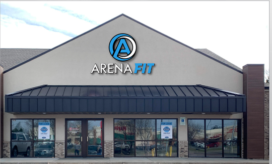 A mockup of the ArenaFit logo on the gym's building.