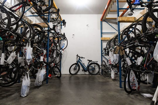 Bikes in need of assembly or repair fill racks in the back room on Wednesday, May 27, at Erik's Bike Shop in Sioux Falls.