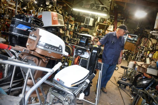 Bruce Reischl talks about some of the vintage boat motors he repairs and collects Tuesday, May 26, 2020, at Bruce's Outboard Shop near Sauk Rapids.