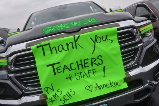 A sign thanks teachers and staff during a commencement ceremony for the Class of 2020 Tuesday, May 26, 2020, at Sauk Rapids-Rice High School.