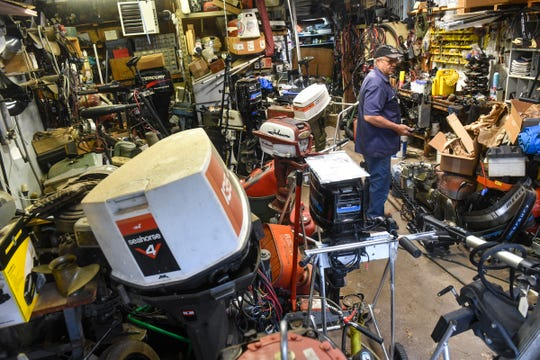 Bruce Reischl stands in a portion of his repair space Tuesday, May 26, 2020, at Bruce's Outboard Shop near Sauk Rapids.