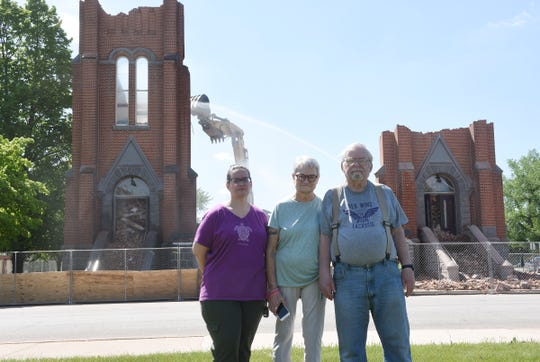 Santina, Micki and Jesse Lovelace pose for a photo as St. Mary's Catholic Church continues to be demolished Wednesday, May 27, 2020, in Melrose.
