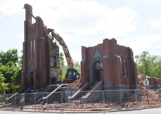 St. Mary's Catholic Church continues to be demolished Wednesday, May 27, 2020, in Melrose.