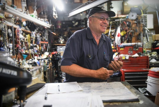Bruce Reischl talks with a customer Tuesday, May 26, 2020, at Bruce's Outboard Shop near Sauk Rapids.