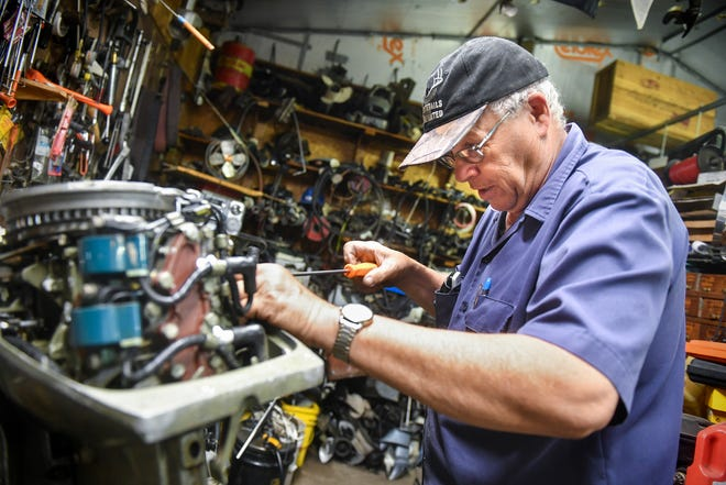 Bruce Reischl installs a new fuel pump on a motor  Tuesday, May 26, 2020, at Bruce's Outboard Shop near Sauk Rapids. Reischl has operated the shop for 40 years.