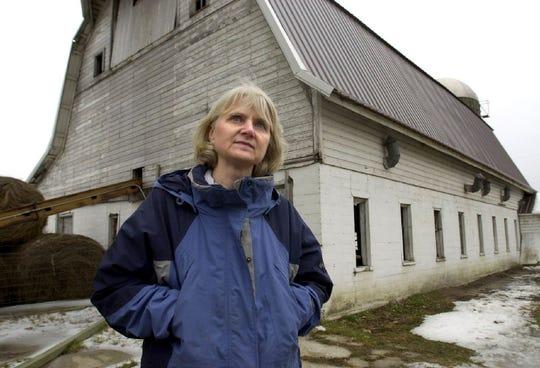 In this April 2003 file photo farmer, lawmaker and widower Mary Ellen Otremba reflects on her farm in Long Prairie, Minn. (AP Photo/Dawn Villella)