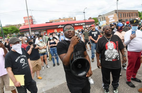 People protest in front of the Minneapolis Police Department's Third Precinct headquarters Wednesday, May 27, 2020, in Minneapolis, Minn.