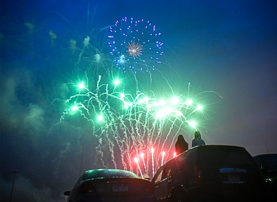 Fireworks fill the sky over the parking lot at Sauk Rapids-Rice High School following the commencement ceremony for the Class of 2020 Tuesday, May 26, 2020.